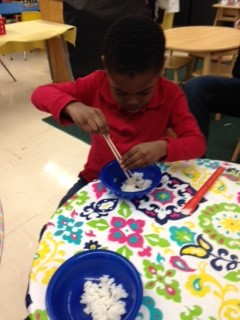 PreK students practiced eating with chop sticks!